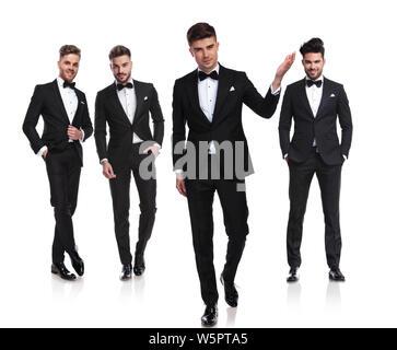 Team von vier Kollegen stehen auf weißen Hintergrund mit Führer treten vor und lädt Sie zu Hochzeit, vollen Körper Bild - Stockfoto