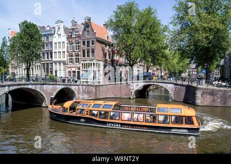 Amsterdam Canal boot Brüssel der Liebenden Kanal Kreuzfahrten an der Keizersgracht/Leidsegracht Kreuzung. - Stockfoto