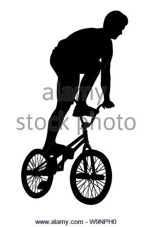Teenager führt ein BMX Fahrrad trick Silhouette - Stockfoto