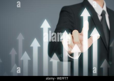 Geschäftsmann Hand berühren Lager informiert auf Wachstum - Stockfoto