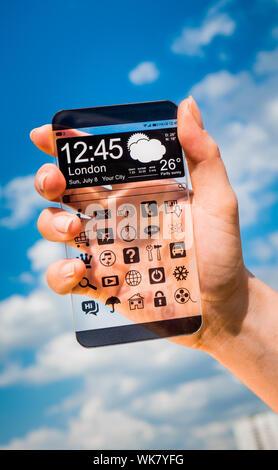 Futuristische Smartphone (Phablet) mit einem transparenten Display in Menschenhand. Tatsächliche zukünftige innovative Konzeptideen und besten Technologien Menschlichkeit. - Stockfoto