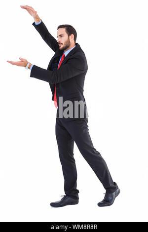 Geschäftsmann etwas mit seinen Händen auf weißem Hintergrund - Stockfoto