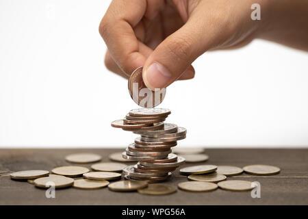 Hand Münzen stack, Konzept, um Geld zu sparen, expandierendes Unternehmen und Vermögende. - Stockfoto