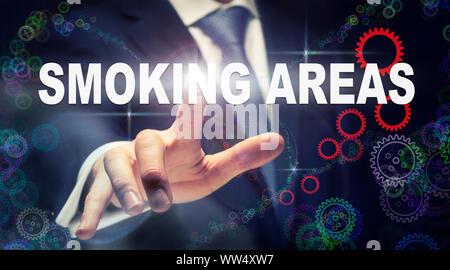 Ein Geschäftsmann Drücken einer Raucherzonen Business Konzept, das auf einer grafischen Darstellung der Zahnräder - Stockfoto