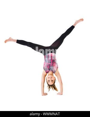Junge Gymnastik Mädchen isoliert auf weißem Hintergrund - Stockfoto