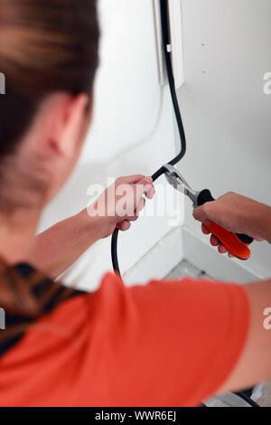 Frauenbeschneidung schwarz elektrischen Draht - Stockfoto