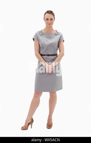 Frau in Kleid ihre Hände vor weißem Hintergrund - Stockfoto