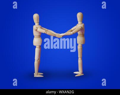 Holzspielzeug Figuren Handshake auf Blau - Stockfoto