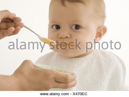 Baby gefüttert - Stockfoto