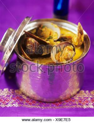 Muscheln in Soße aus Goa, Indien - Stockfoto