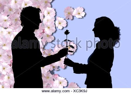 Silhouetten, stieg der Mann junge Frau - Stockfoto