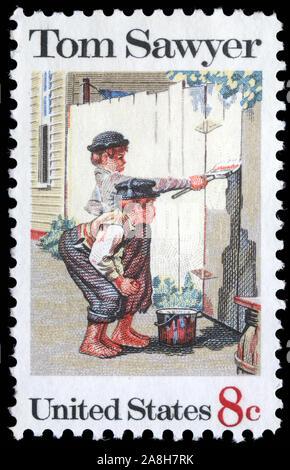 Sello impreso en EE.UU. muestra la pintura 'Tom Sawyer', por Norman Rockwell (1894-1978), American Folklore problema, circa 1972 Foto de stock