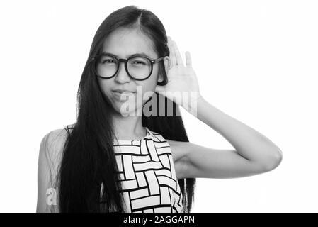 Jóvenes adolescentes asiáticas nerd girl pensando mientras escucha Foto de stock