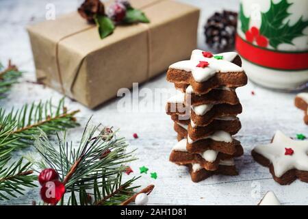 Esmerilado de Navidad star cookies en celebrar la fiesta antecedentes