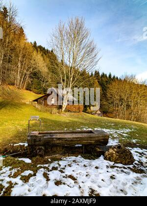 Ferienhaus Am Waldrand, Dornbirn, Austria, Brunnen, Hütte, Wenig Schnee Im Winter, Sonniger Himmel, Ingeborg Kuhn, Österreich, Schauner,