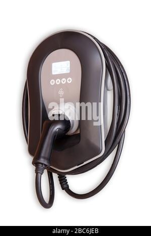 Cargador de coche eléctrico Zappi para el hogar en una pared en una situación de garaje para el hogar. Cargador de coche eléctrico para el hogar .cargador de coche en el garaje en casa Foto de stock