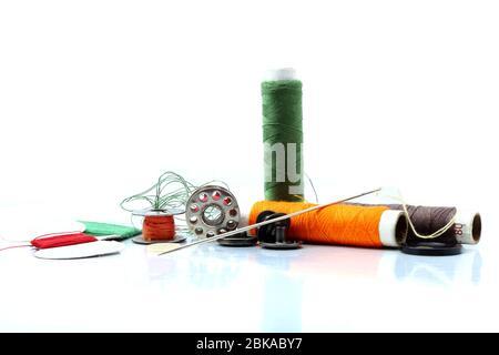 Herramientas y accesorios de costura o materiales de confección.
