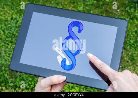 Ilustración de un signo de párrafo azul con sombra en un pantalla de la tableta