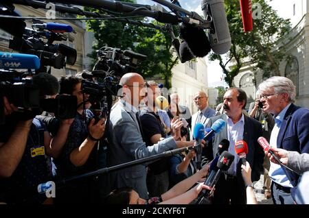 French Force Ouvriere (FO) labour union General Secretary Jean-Claude Mailly (R) and French CGT trade union head Philippe Martinez (2ndR) speak with journalists as they leave after a meeting with the Interior minister in Paris, France, June 22, 2016 after French police banned a planned demonstration this week against labour reforms, bringing to a head a stand-off between the government and trade unions which have been spearheading protests against the changes for months.  REUTERS/Stephane Mahe