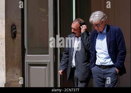 French Force Ouvriere (FO) labour union General Secretary Jean-Claude Mailly (R) and French CGT trade union head Philippe Martinez leave after a meeting with the Interior minister in Paris, France, June 22, 2016 after French police banned a planned demonstration this week against labour reforms, bringing to a head a stand-off between the government and trade unions which have been spearheading protests against the changes for months.   REUTERS/Stephane Mahe