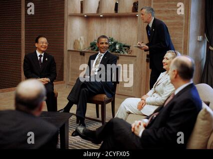 U.S. President Barack Obama (2nd L) and Secretary of State Hillary Clinton (2nd R) meet with China's Premier Wen Jiabao (L) on the sidelines of the East Asia Summit in Nusa Dua, Bali, November 19, 2011. U.S. National Security Advisor Thomas Donilon sits on the right.   REUTERS/Jason Reed   (INDONESIA - Tags: POLITICS)