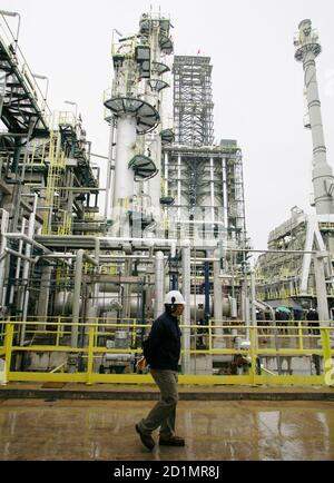 A worker from Chile's state oil company ENAP passes during the inauguration of a new oil refinery plant in Concon City, about 75 miles (120 km) northwest of Santiago, August 4, 2008. Chile expects to import less diesel fuel in the second half of the year after higher rains raised the amount of electricity it can generate through hydro power. REUTERS/Eliseo Fernandez(CHILE)