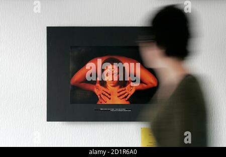 A visitor walks past creation of Kazakh artists Dinara Atkesheva, AmeliE Roshkina, Liana Bakhalova and Roman Andreev, which is a part of the project dubbed 'The Picture Of Dorian Gray', at the 'Seismograms' exhibition at the Soros Centre for Contemporary Art in Almaty December 15, 2006.  REUTERS/Shamil Zhumatov (KAZAKHSTAN)
