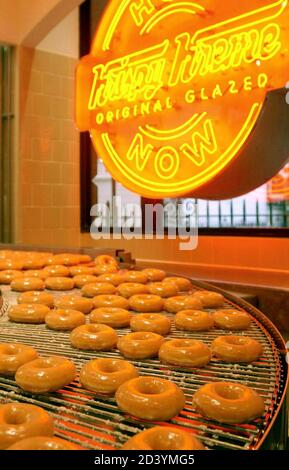 Krispy Kreme doughnuts go into production at the opening of the store at Harrods in London, October, 3, 2003. [The U.S. chain opened its first European outlet in London on Friday.]