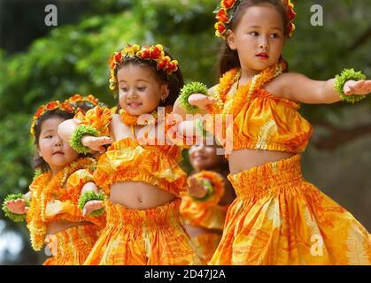 Keiki (children) hula dancers of Halau Hula 'O Hokulani of Waipahu, Hawaii perform during the 64th Annual Na Hula Festival at the Kapiolani Park across from Waikiki Beach in Honolulu, Hawaii August 8, 2004. The festival continues on August 22, 2004. REUTERS/Lucy Pemoni  LP