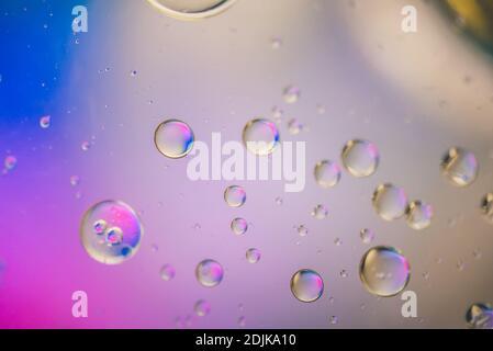 Gotas de aceite en agua. Imagen patrón psicodélico abstracto multicolor. Resumen antecedentes con coloridos colores de degradado. Foto de stock