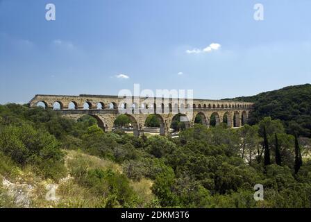 The Pont du Gard is an ancient Roman aqueduct that crosses the Gardon River, Vers-Pont-du-Gard, near Remoulins, in Provence, France.