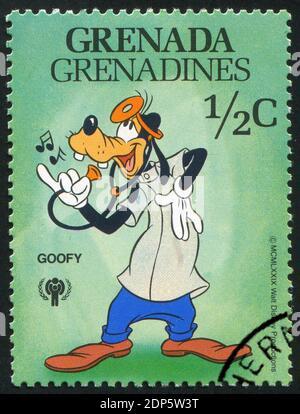 GRANADA - ALREDEDOR de 1979: Sello impreso por Granada, muestra personajes de Walt Disney, Doctor Goofy, alrededor de 1979