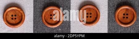 Botones redondos de costura marrón de madera aislados sobre fondo textil. Vista superior. De cerca. Macro.