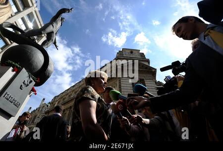 Elena Gagarina, the daughter of Yuri Gagarin, the first man in space, talks to the media after unveiling a statue of him outside the British Council headquarters in central London July 14, 2011   REUTERS/Paul Hackett  (BRITAIN - Tags: SOCIETY POLITICS)