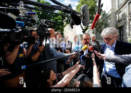 French Force Ouvriere (FO) labour union General Secretary Jean-Claude Mailly (R) and French CGT trade union head Philippe Martinez (2ndR) speak with journalist as they leave after a meeting with the Interior minister in Paris, France, June 22, 2016 after French police banned a planned demonstration this week against labour reforms, bringing to a head a stand-off between the government and trade unions which have been spearheading protests against the changes for months.  REUTERS/Stephane Mahe
