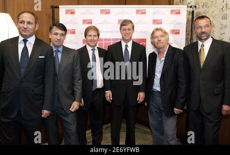 Global Business Coalition On HIV/AIDS awards recipients (L-R) John Demsey, CEO and Global President, MAC; Jonathan Klein, CEO, Getty Images; Jonathan Oppenheimer, Managing Director, De Beers; Peter Dolan, CEO, BMS; Sir Richard Branson, Chairman, Virgin; and Andreas Tostmann, Managing Director, Volkswagen of South Africa, pose for photographs at the Kennedy Center for the Performing Arts in Washington, D.C., September 28, 2005. The GBC is hosting events this week in Washington to applaud companies active in the global AIDS fight, to coordinate the private sector response to the AIDS pandemic an