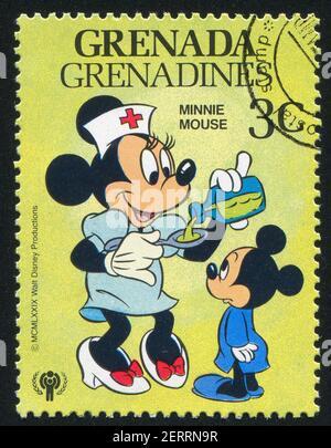 GRANADA - ALREDEDOR de 1979: Sello impreso por Granada, muestra los personajes de Disney, alrededor de 1979