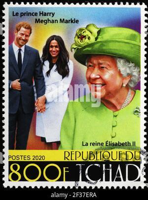 Reina Isabel II, Harry y Megan Markle en sello postal