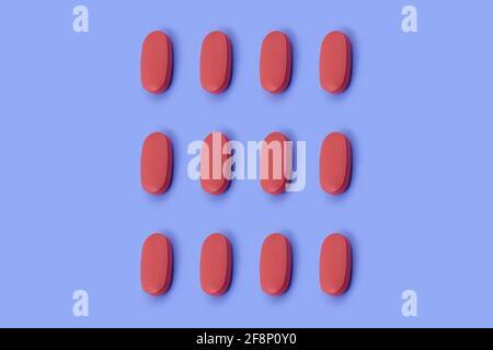 Forma ovalada tableta de medicina farmacéutica sobre fondo azul, Medicina conceptos creativos estilo mínimo con fondo de papel colorido
