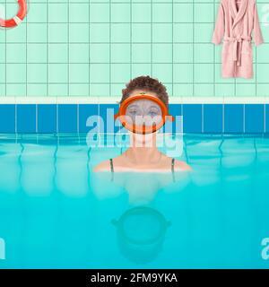 Mujer en piscina cubierta con gafas de buceo (M)