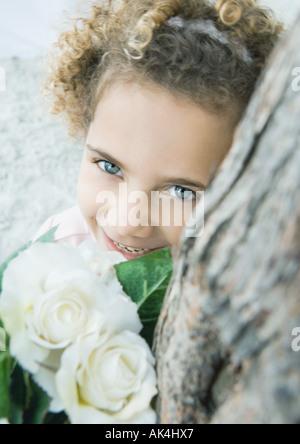 Muchacha con flores.