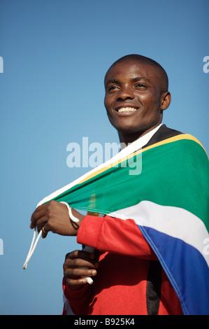 Jugador de fútbol con la bandera de Sudáfrica en Pretoria la provincia de Gauteng en Sudáfrica Foto de stock