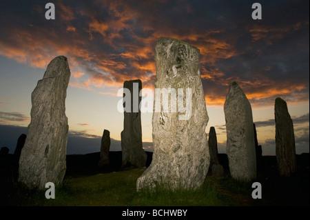 Callanish Stone Circle, el neolítico, Piedras, puesta de sol en el solsticio de verano, la isla de Lewis, Hébridas Exteriores, Escocia