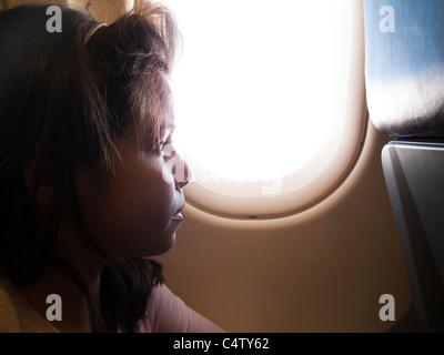 Chica ,9 años,en un avión