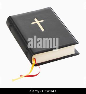 Biblia cristiana contra el fondo blanco, cerrar