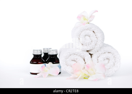 Laminada blanca hasta spa toallas y productos para el cuidado corporal con orquídeas