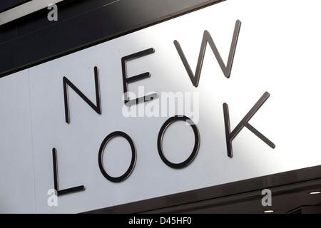 Signo para tienda de ropa nueva apariencia. Foto de stock
