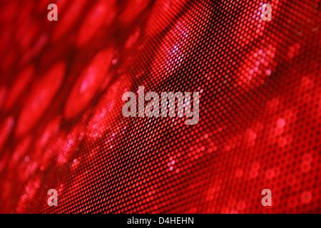 Ángulo de visión de una pantalla de LED que muestra la imagen elegante en rojo. Profundidad de campo para un efecto borroso.