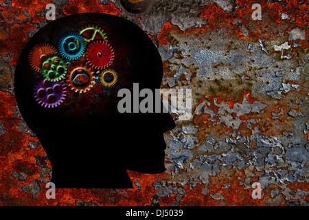 Rusty coloridos engranajes metálicos en cabeza humana silueta Grunge Textura del fondo