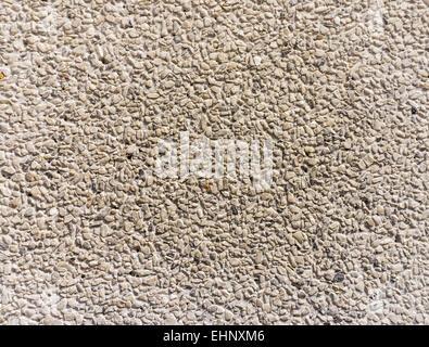 Pared de roca de granito gris claro Textura del fondo